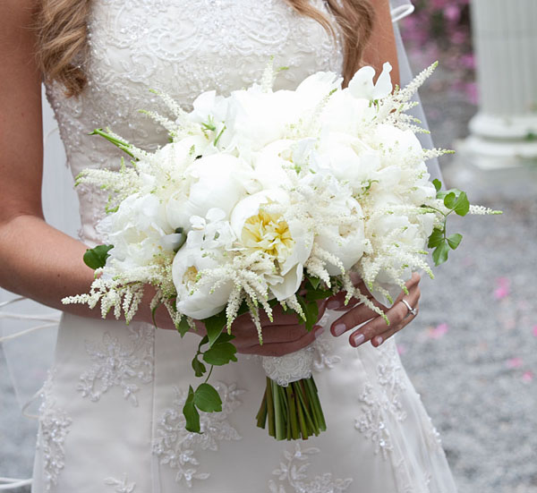 White Astilbe softens the structure of this peony bouquet.