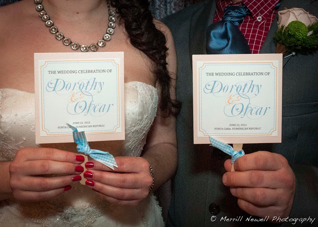 Ceremony Programs that doubled as paper fans. Great for a summer wedding!