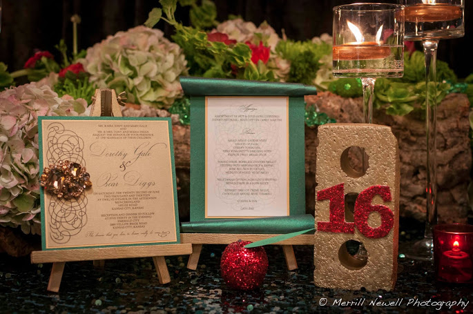 Reception stationary featured crystal brooches on invitations, scroll style menu and a gold brick table number, all by Paper Angels.
