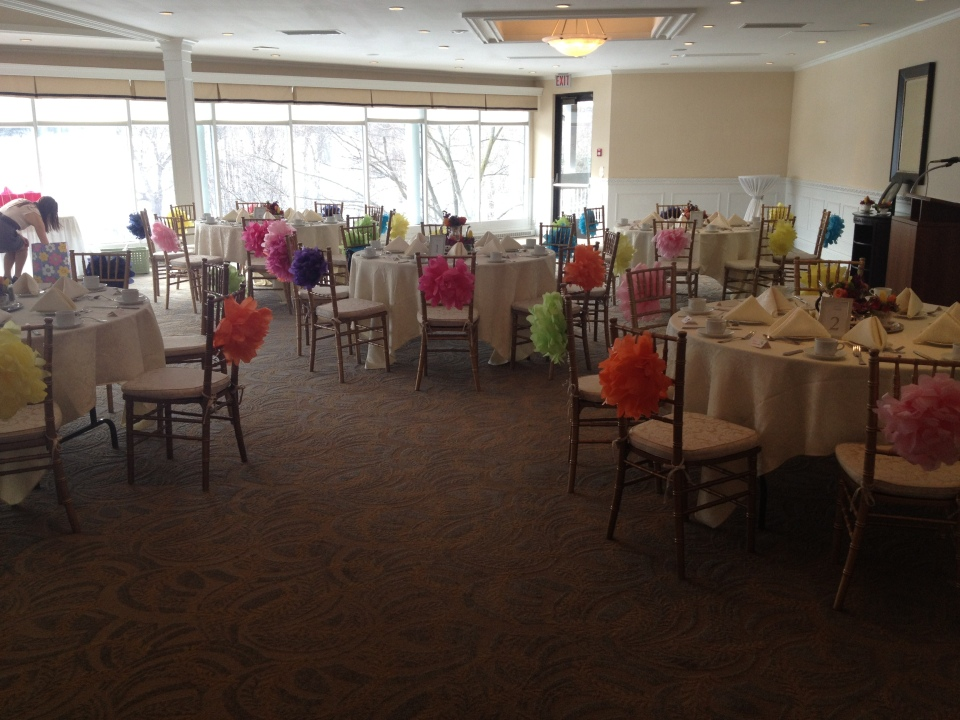 Tissue paper flowers on the chair backs really brightened up the room.
