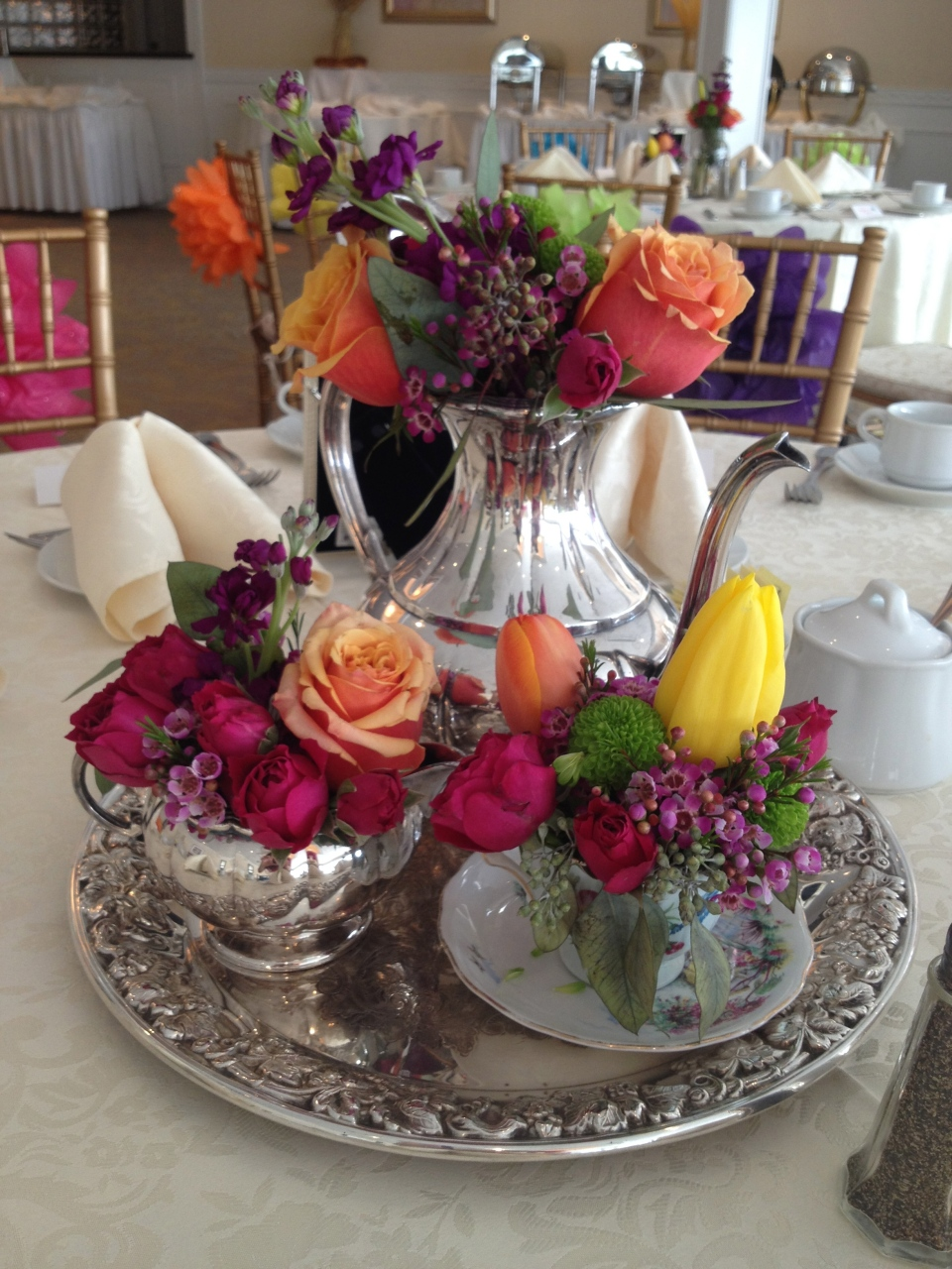 Colourful blooms in silver tea service