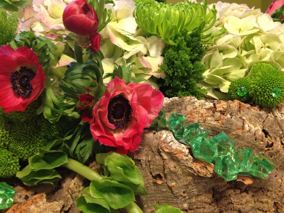 Wedding in Oz centerpiece details of poppies and emeralds