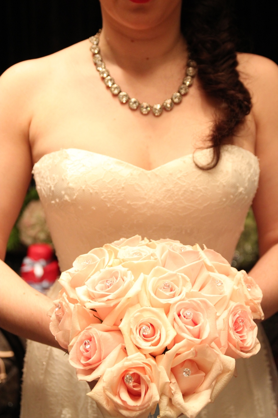 Blush rose bouquet with crystal accents for the ceremony.