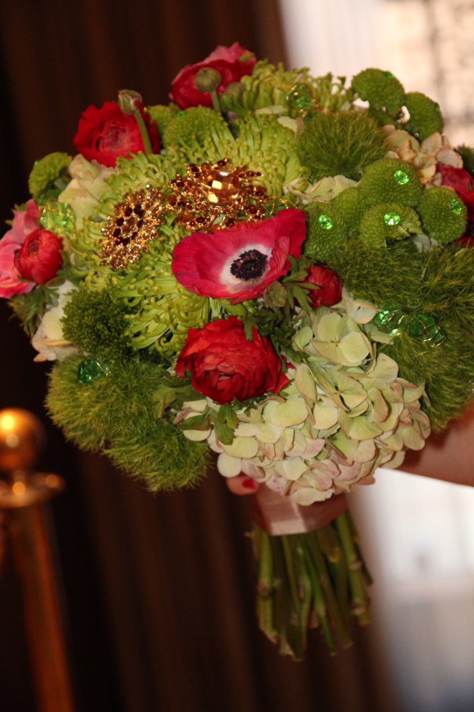 Wizard of Oz themed bridal bouquet with red poppies and emerald accents