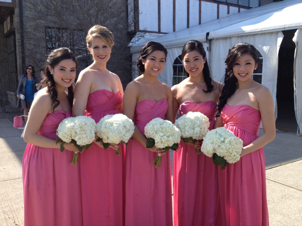 Bridesmaids bouquets of white hydrangea
