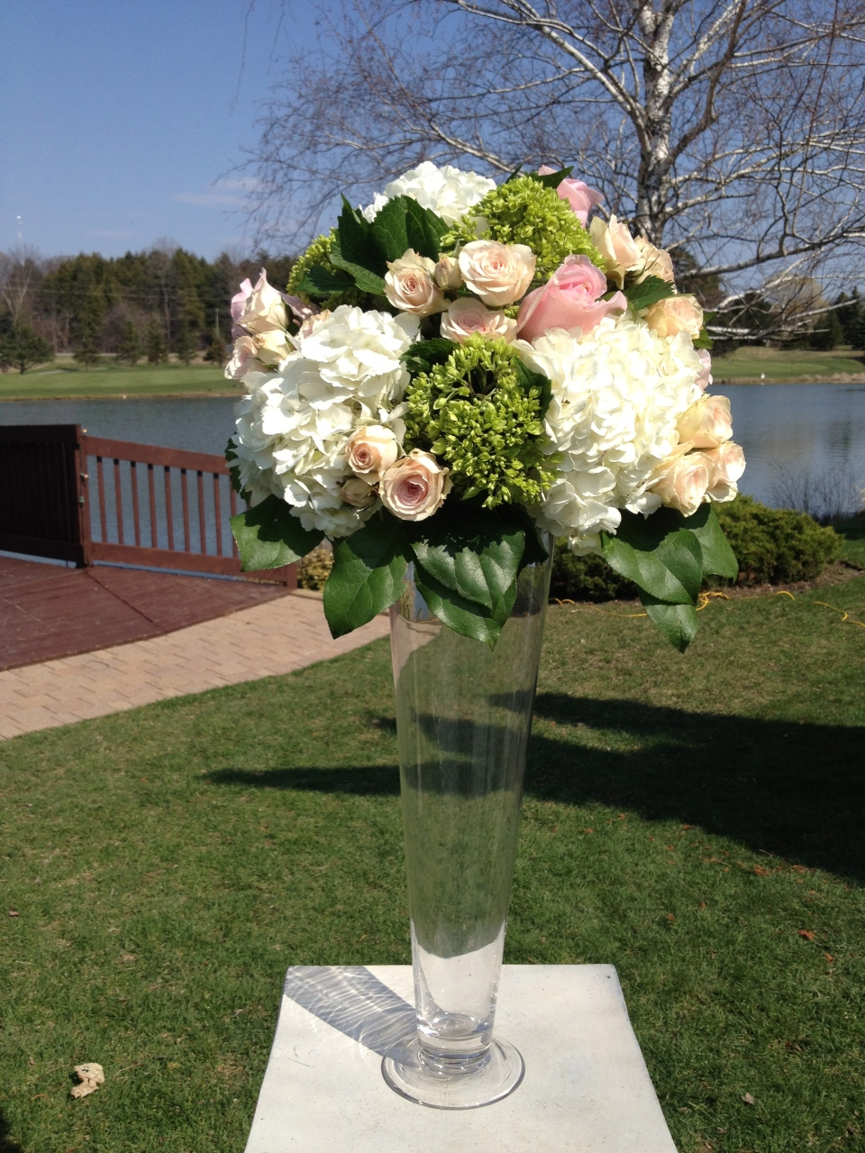 Ceremony flowers of hydrangea and roses at The Manor