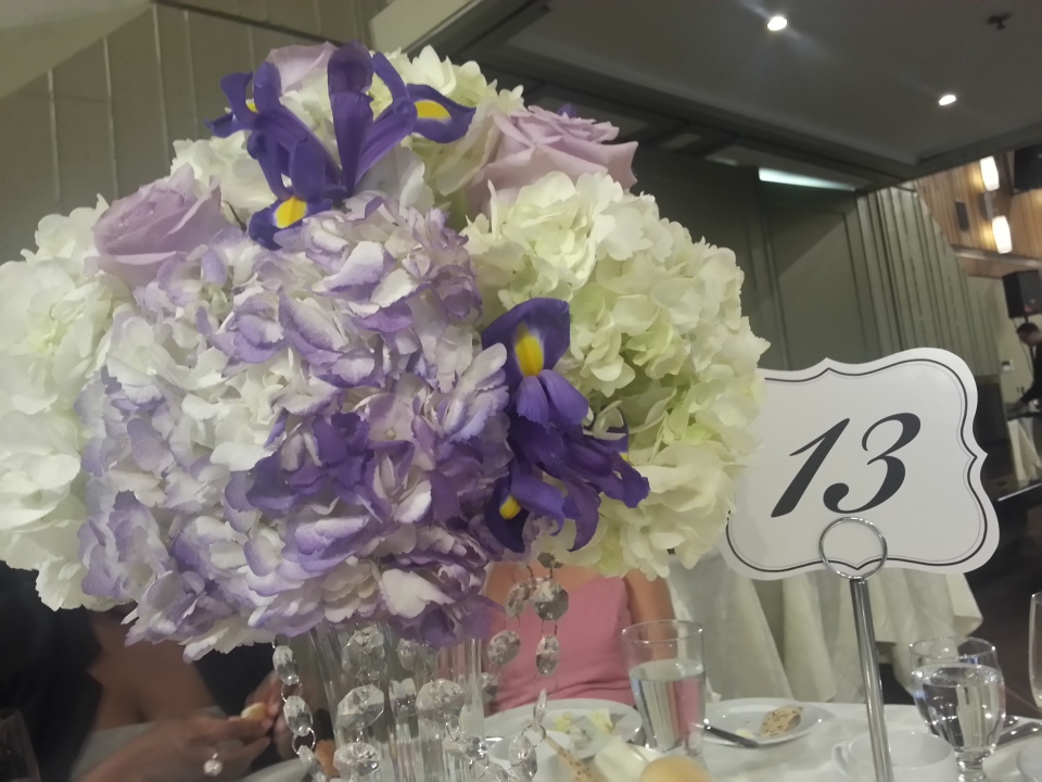 Simple centerpieces of hydrangea, roses and iris.
