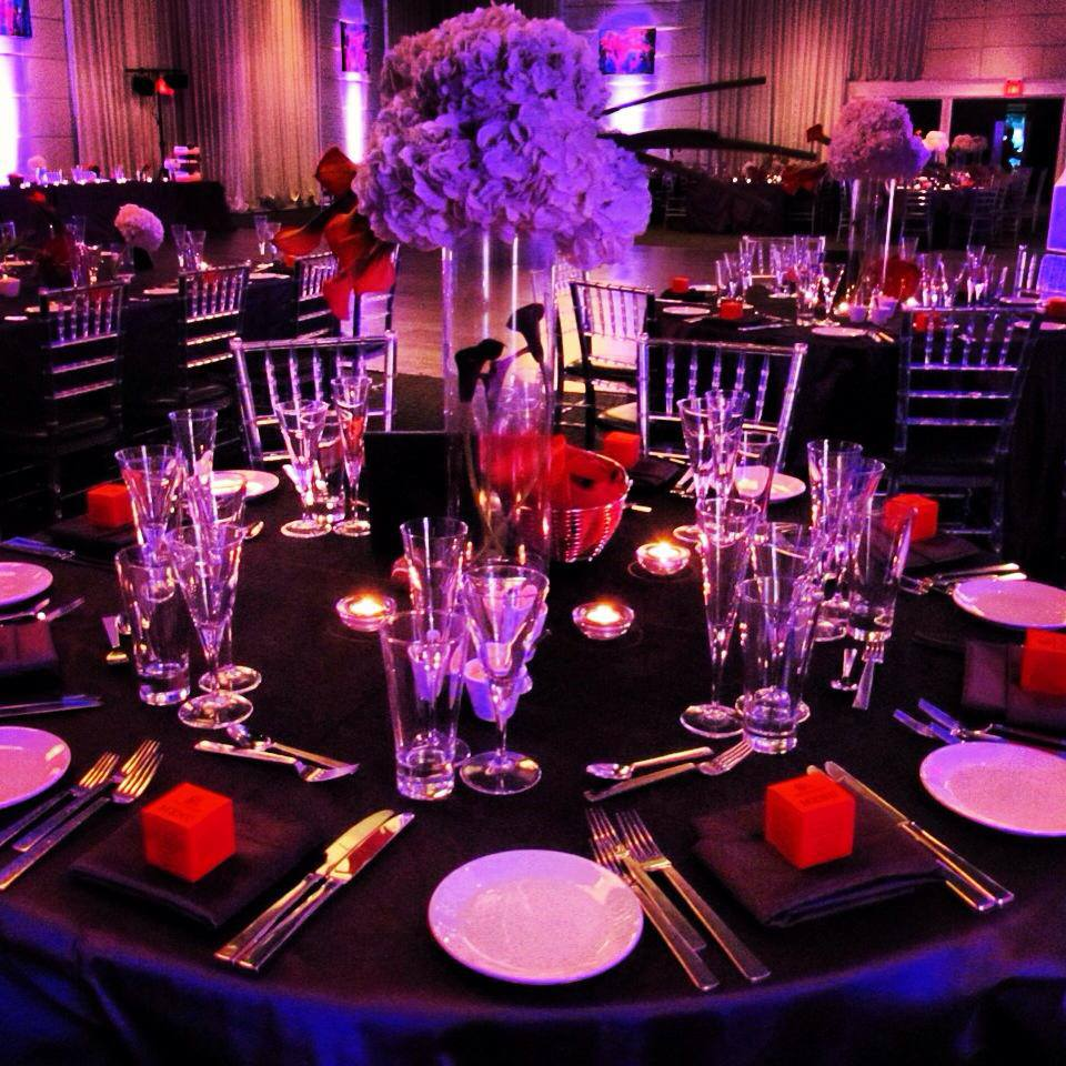 Modern reception decor in purple and orange at The Grand Luxe