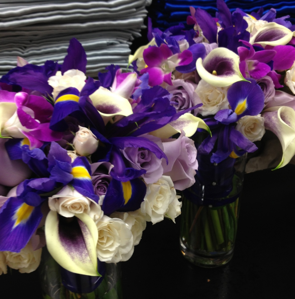 Bouquets of calla lilies, orchids, roses and purple iris