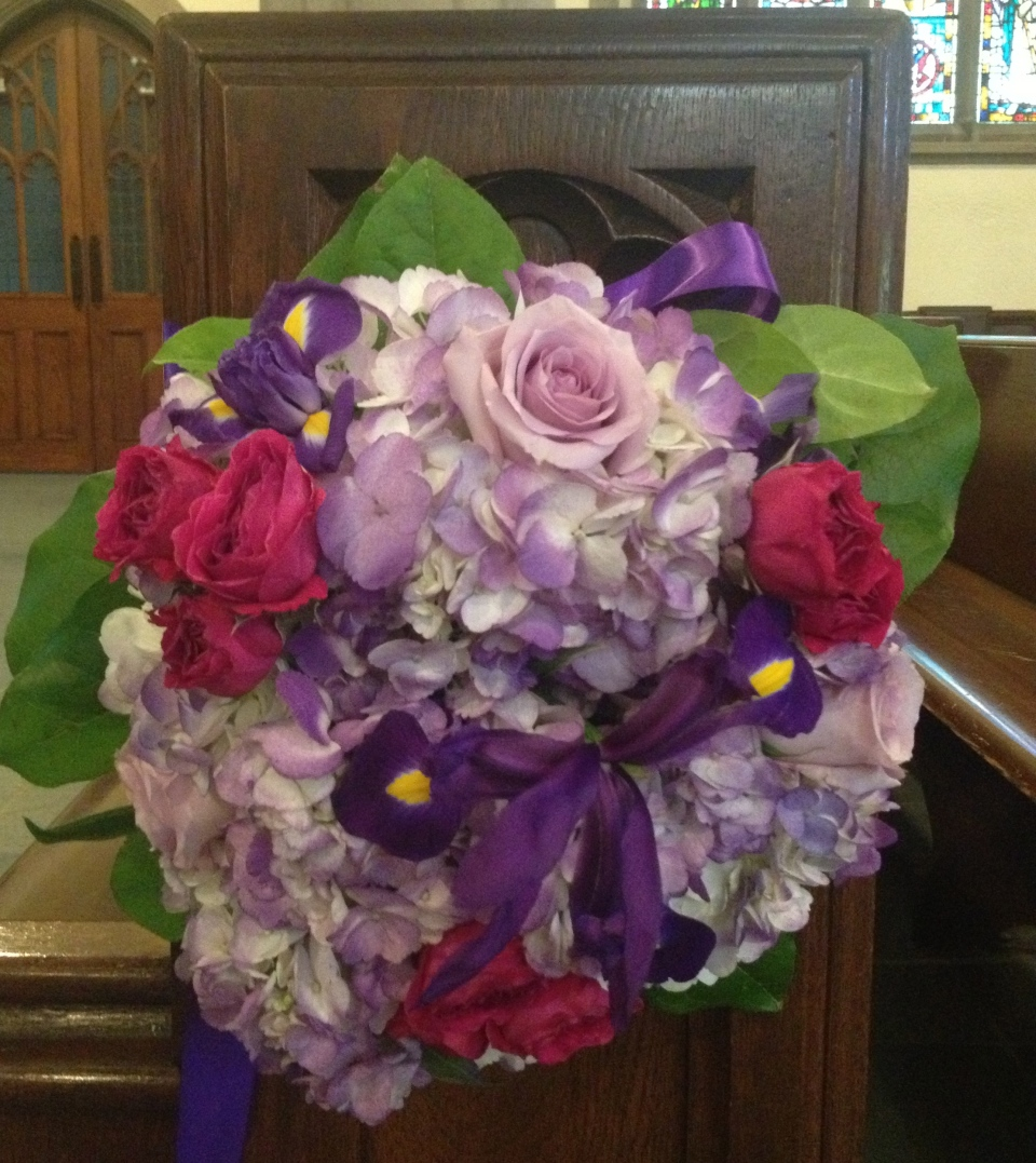 Pew markers with iris, roses and hydrangea