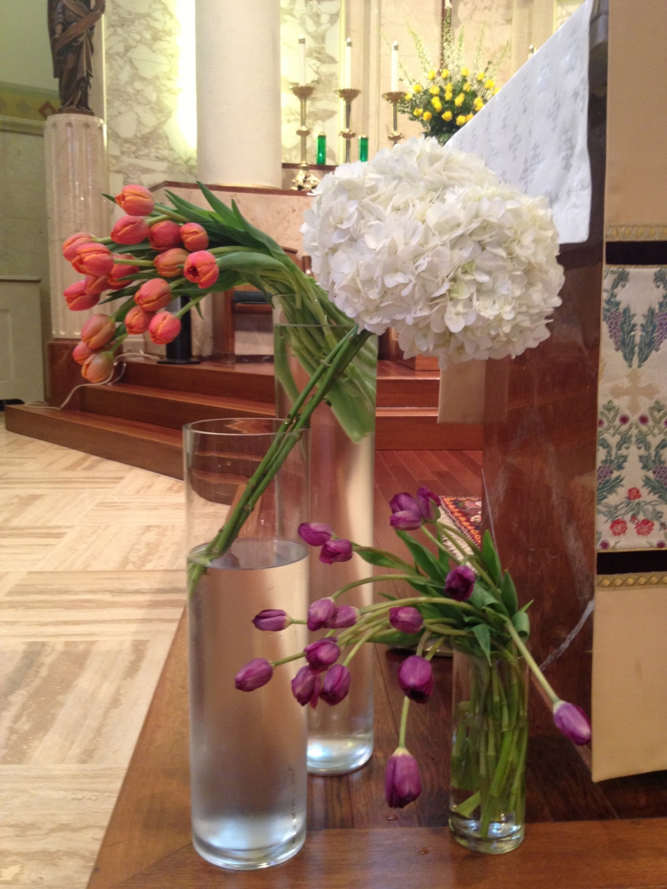 Cascading tulips and hydrangea groupings make for simple but stunning altar pieces.