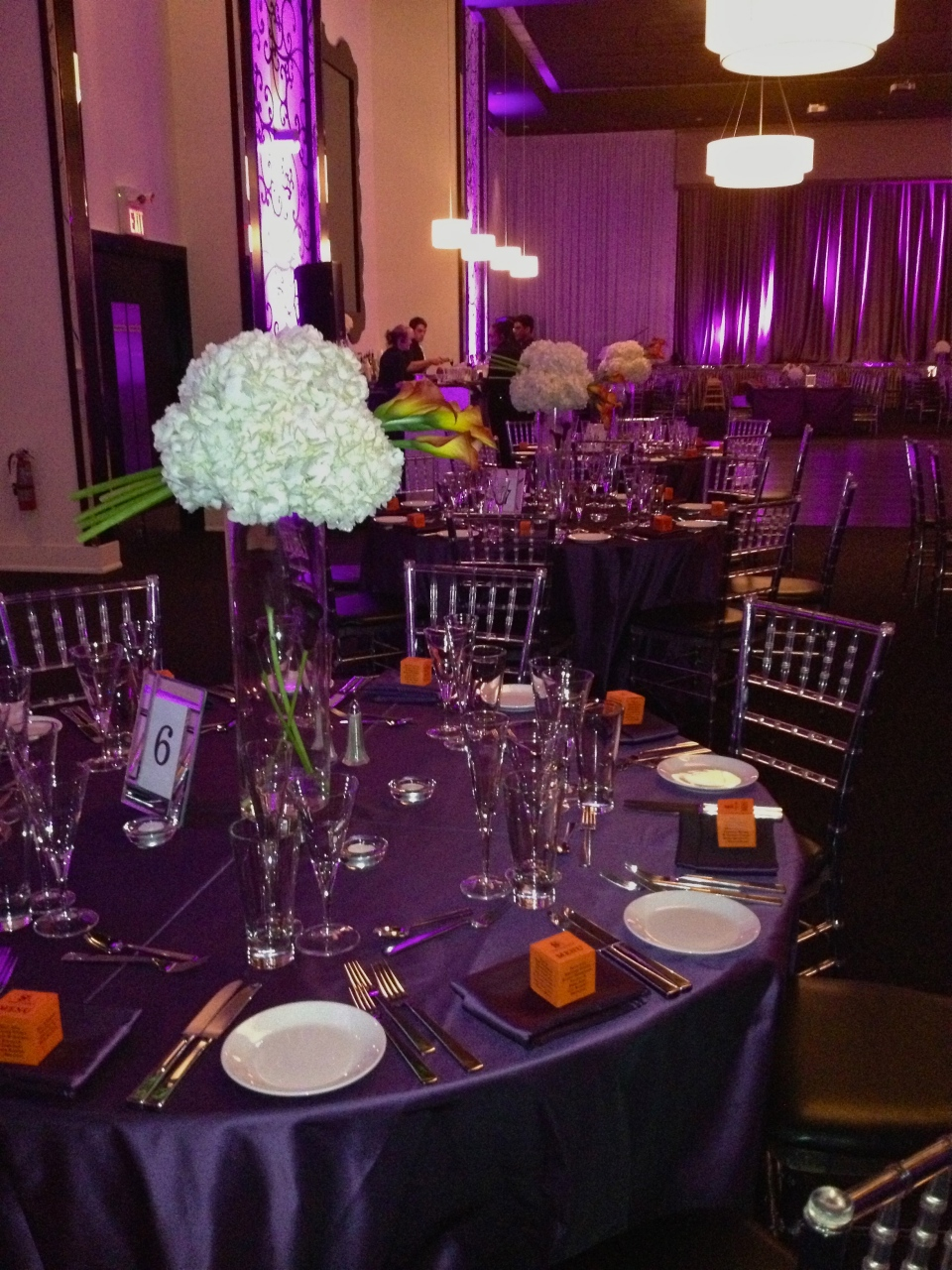 Modern centerpieces with hydrangea globe and sculpted calla lilies at The Grand Luxe
