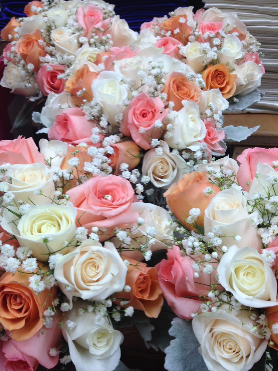Peach, pink and white rose bouquet with baby's breath