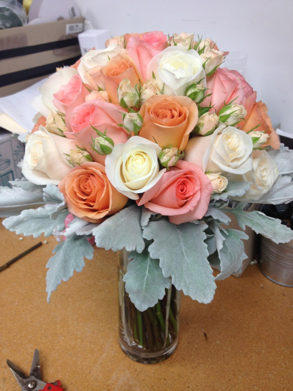 Peach, pink and white rose bouquet with dusty miller