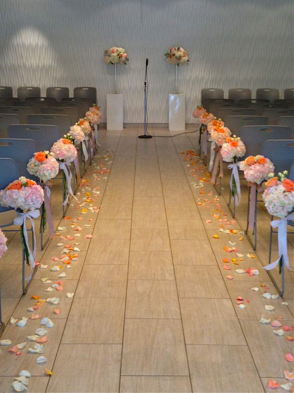Peach and pink aisle markers of hydrangea and roses