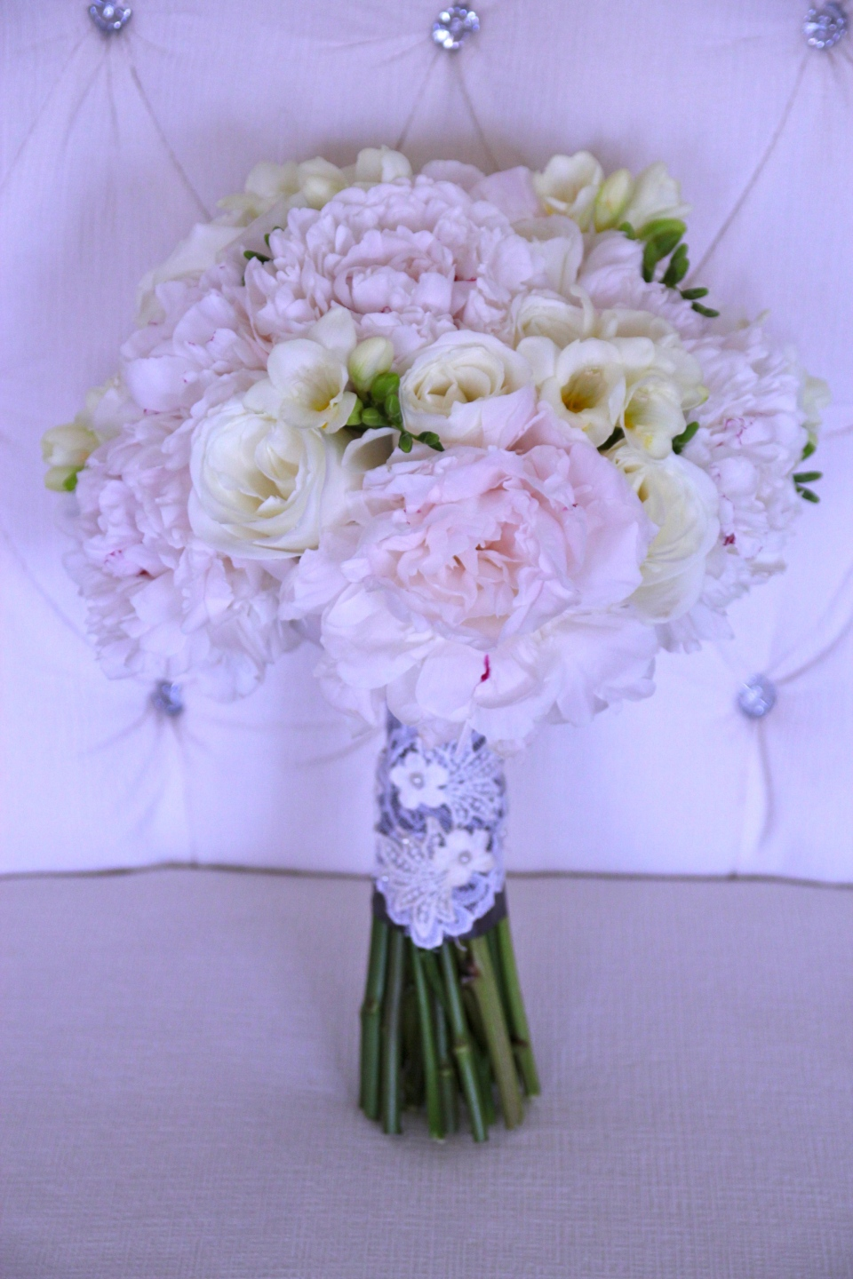 White bridal bouquet of peony, roses and freesia