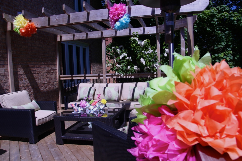 Bright tissue flowers on the lovely back deck!