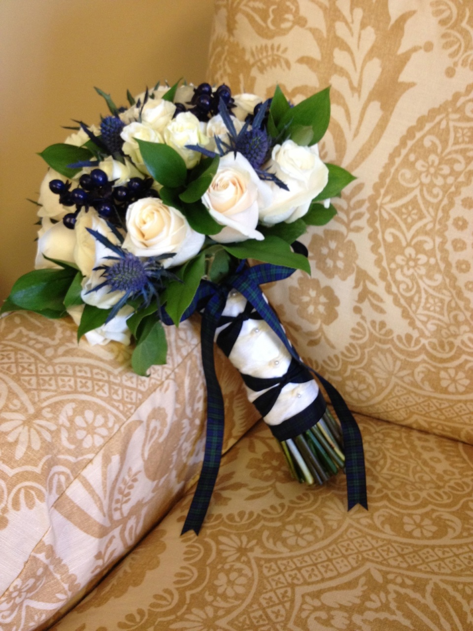 The Scottish Thistle in this bouquet and matching tartan ribbon were a tribute to the groom's Scottish heritage.
