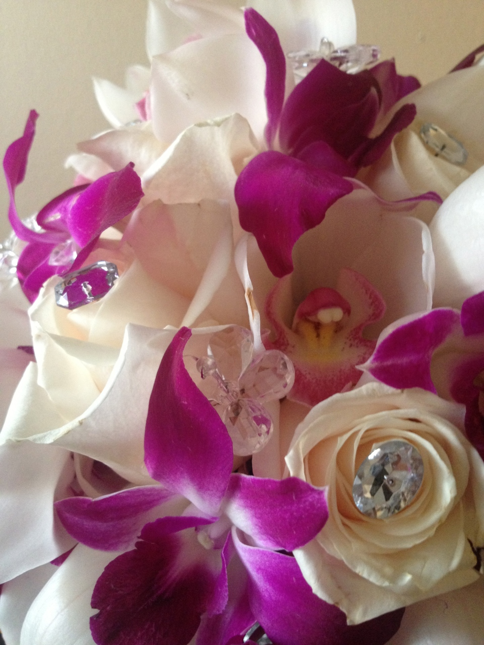 Orchid and rose bouquet with bouquet jewelry