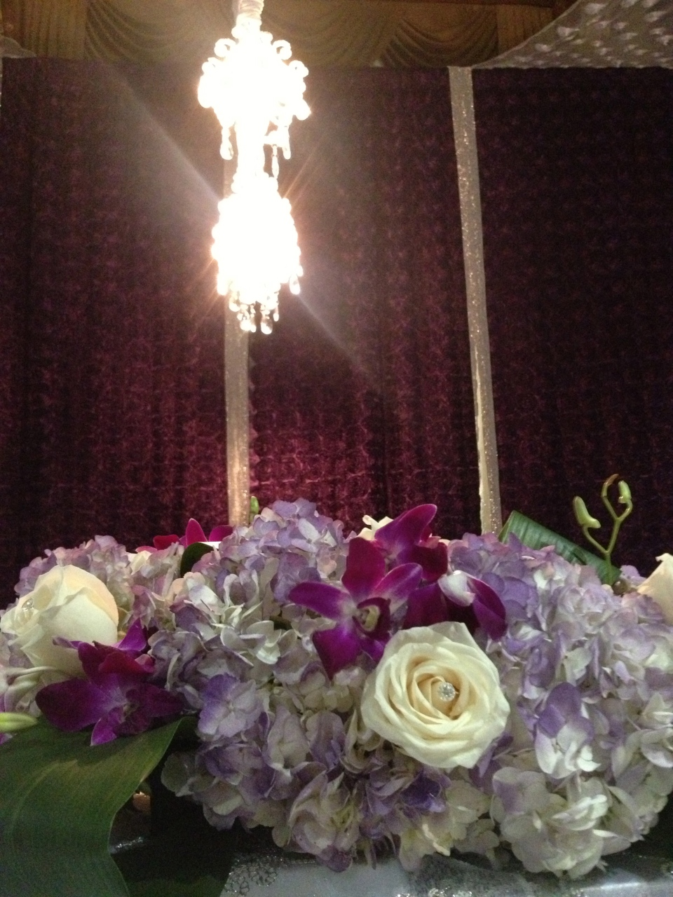 Head table arrangements of hydrangea, roses and dendrobium orchids for the head tables.