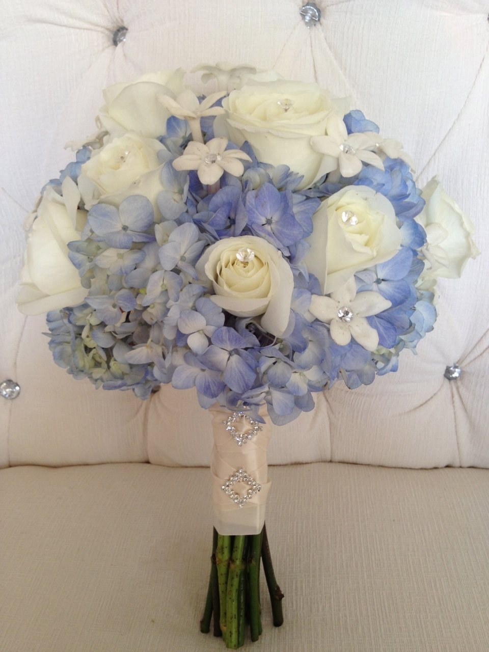 Bridal bouquet of blue hydrangea, white roses and stephanotis