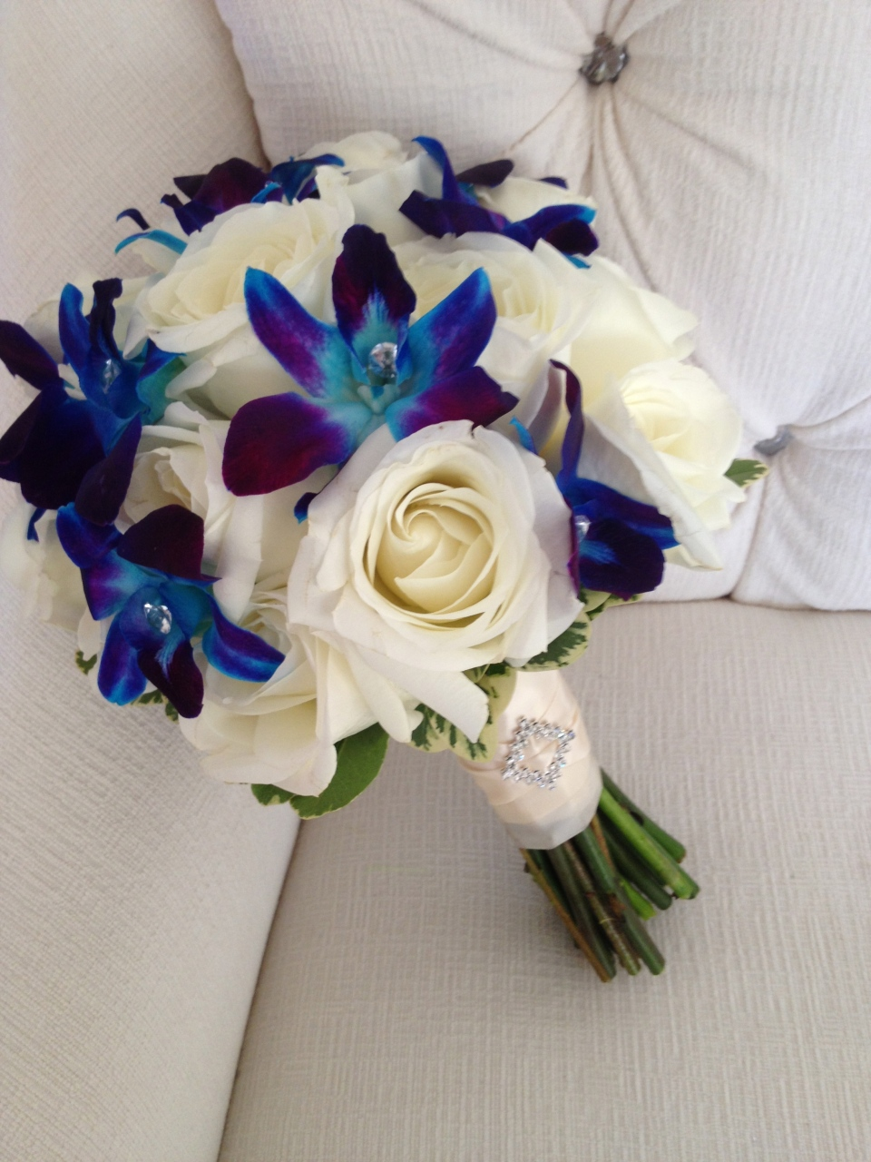 White rose and blue dendrobium orchid bouquet