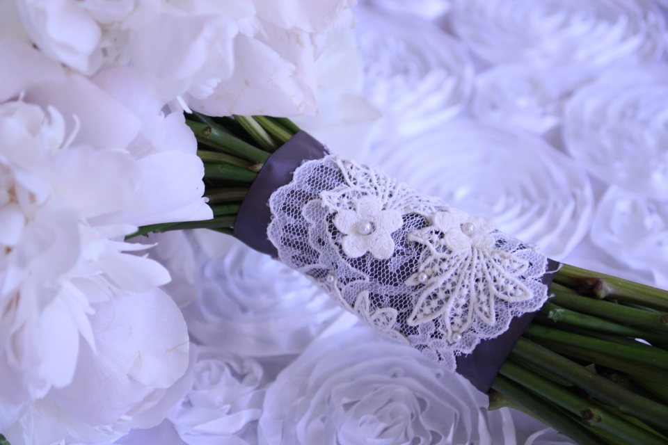 A custom lace wrap made of lace from both the mother of the bride and the mother of the groom's wedding dresses.