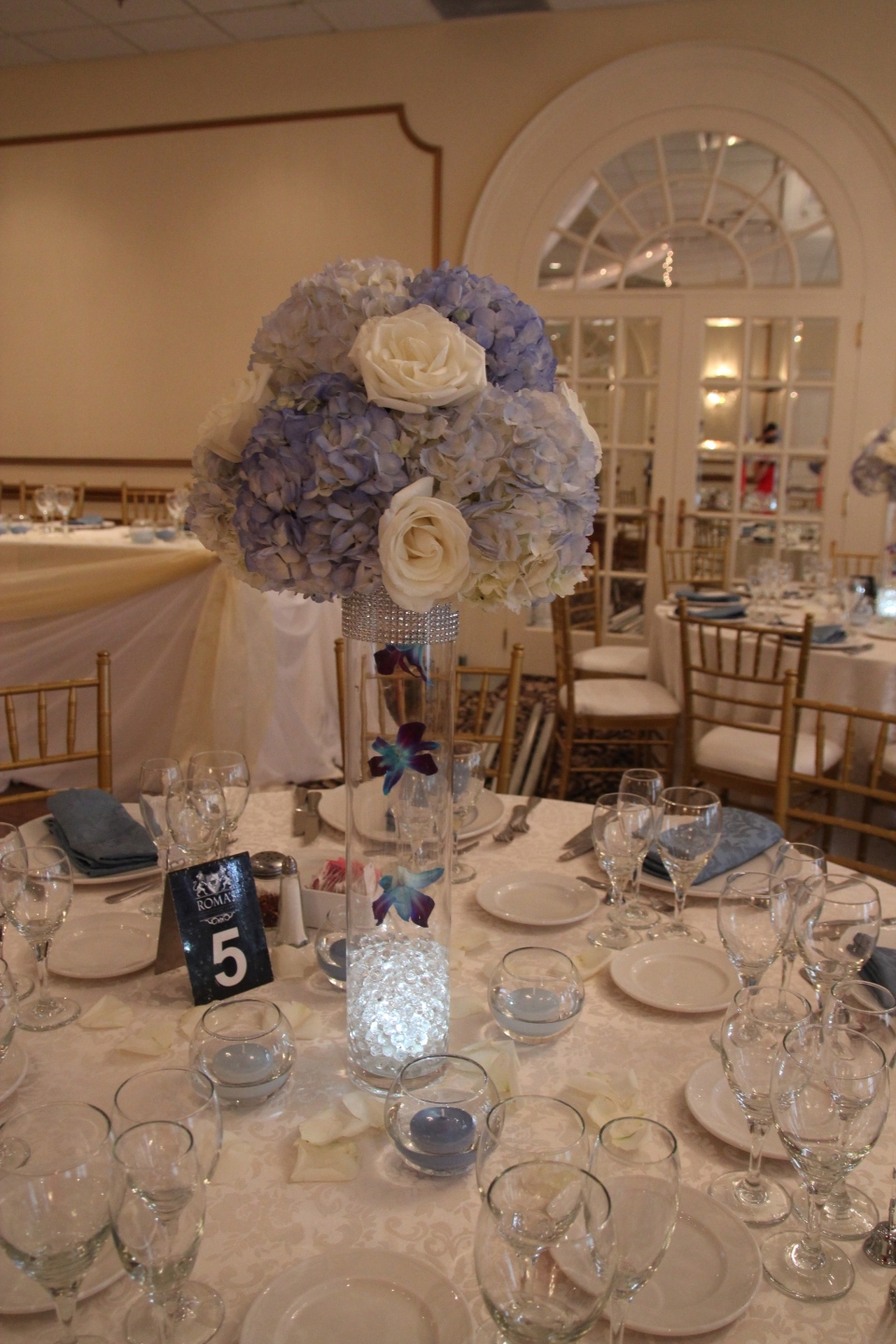 Blue and white centerpieces with suspended orchids