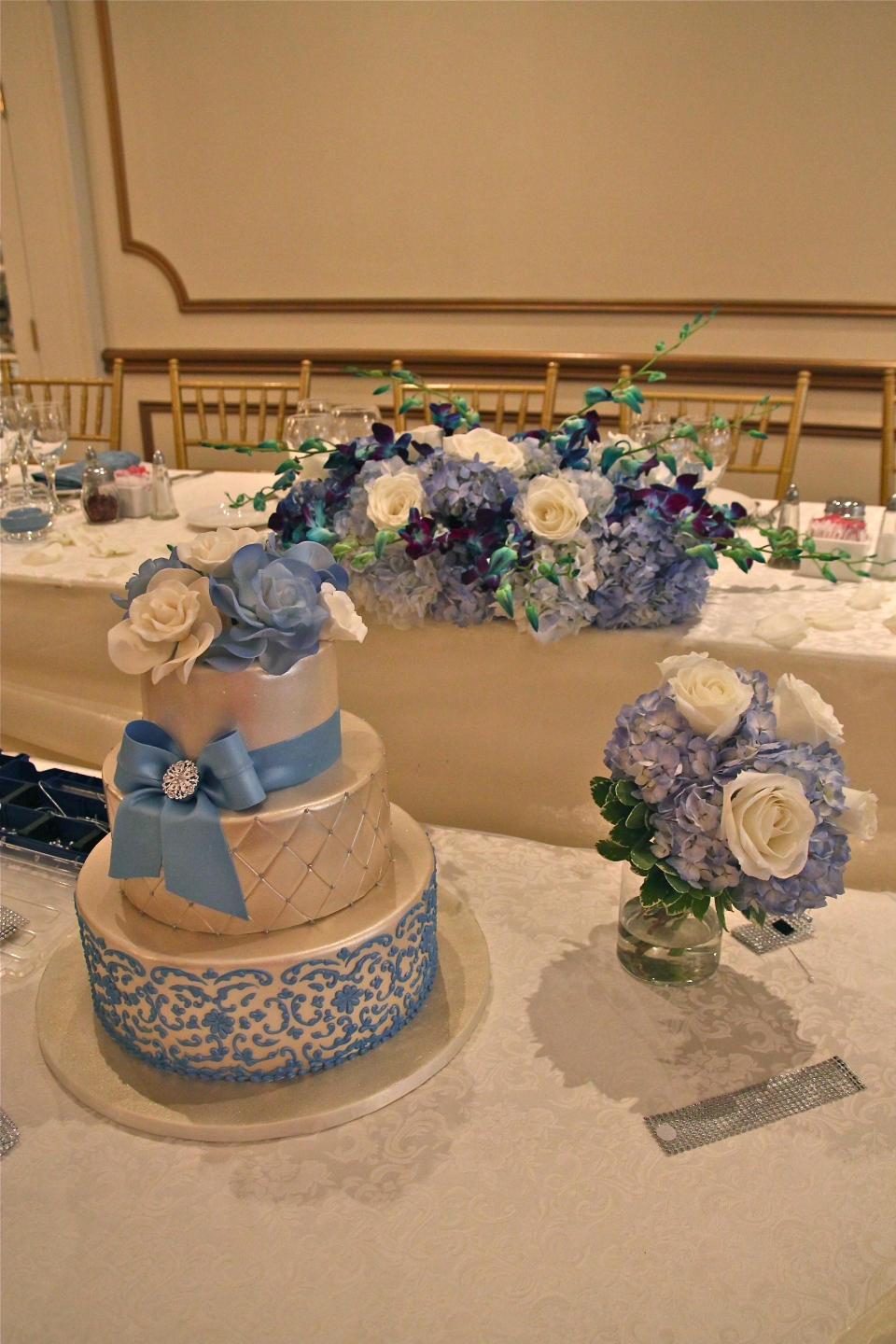 Blue and white head table and cake table decor