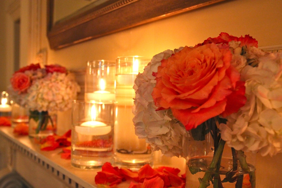 Floating candles and small florals lined up along each mantle.
