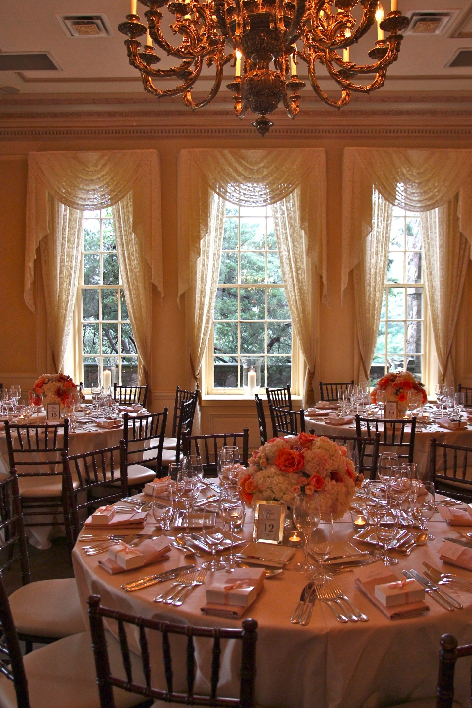 Coral, peach and ivory centerpieces at Graydon Hall