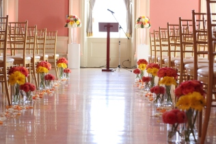 Coral and Yellow Ceremony Flowers at St. Lawrence Hall