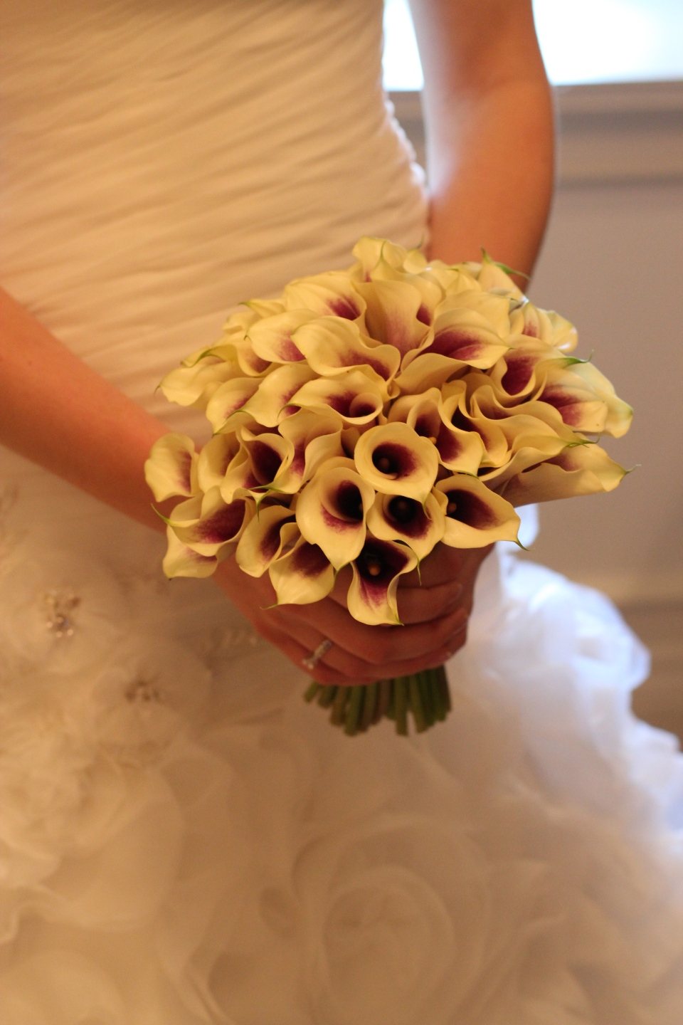 Bridal bouquet of Picasso Calla Lilies.