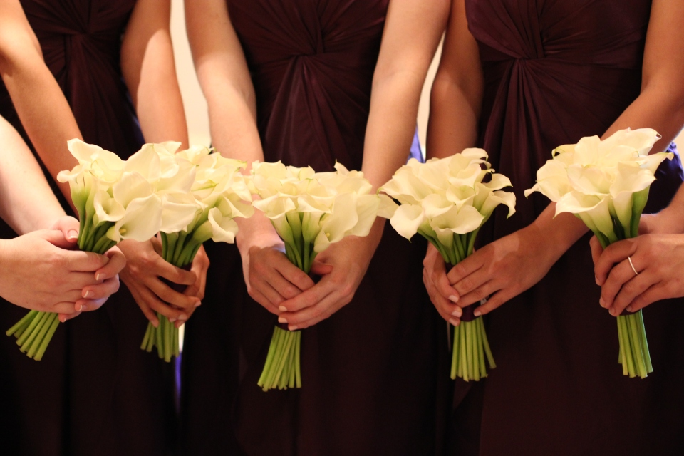 Bridesmaids bouquets of white calla lilies
