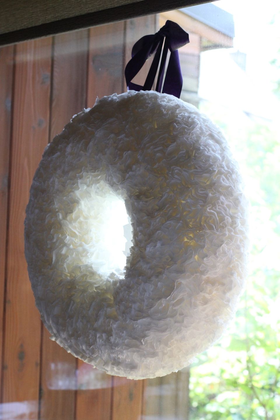 Handmade wreath's for the windows made by the bridal partyout of coffee filters