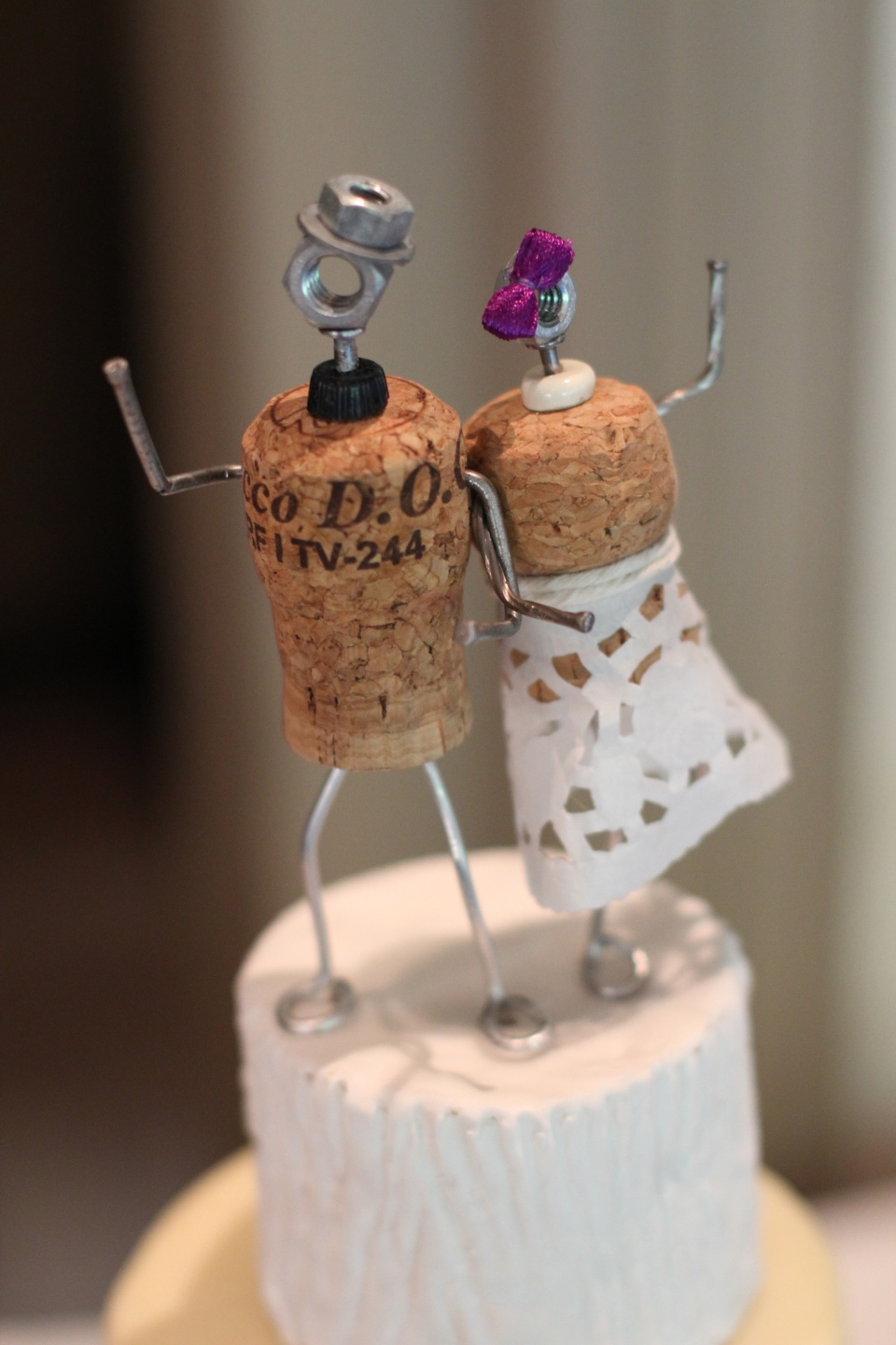 The adorable cake topper hand made by the groom!