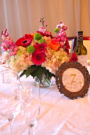 Fall centerpiece of mums, roses, stock, gerbera daisies, button poms and hydrangea in rich fall colours
