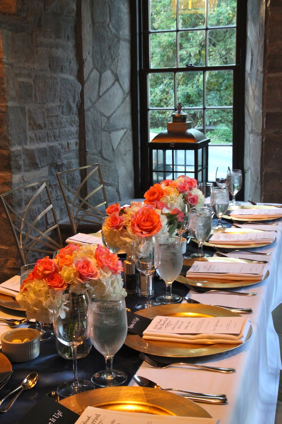 Coral and navy wedding centerpieces at the Ancaster Mill