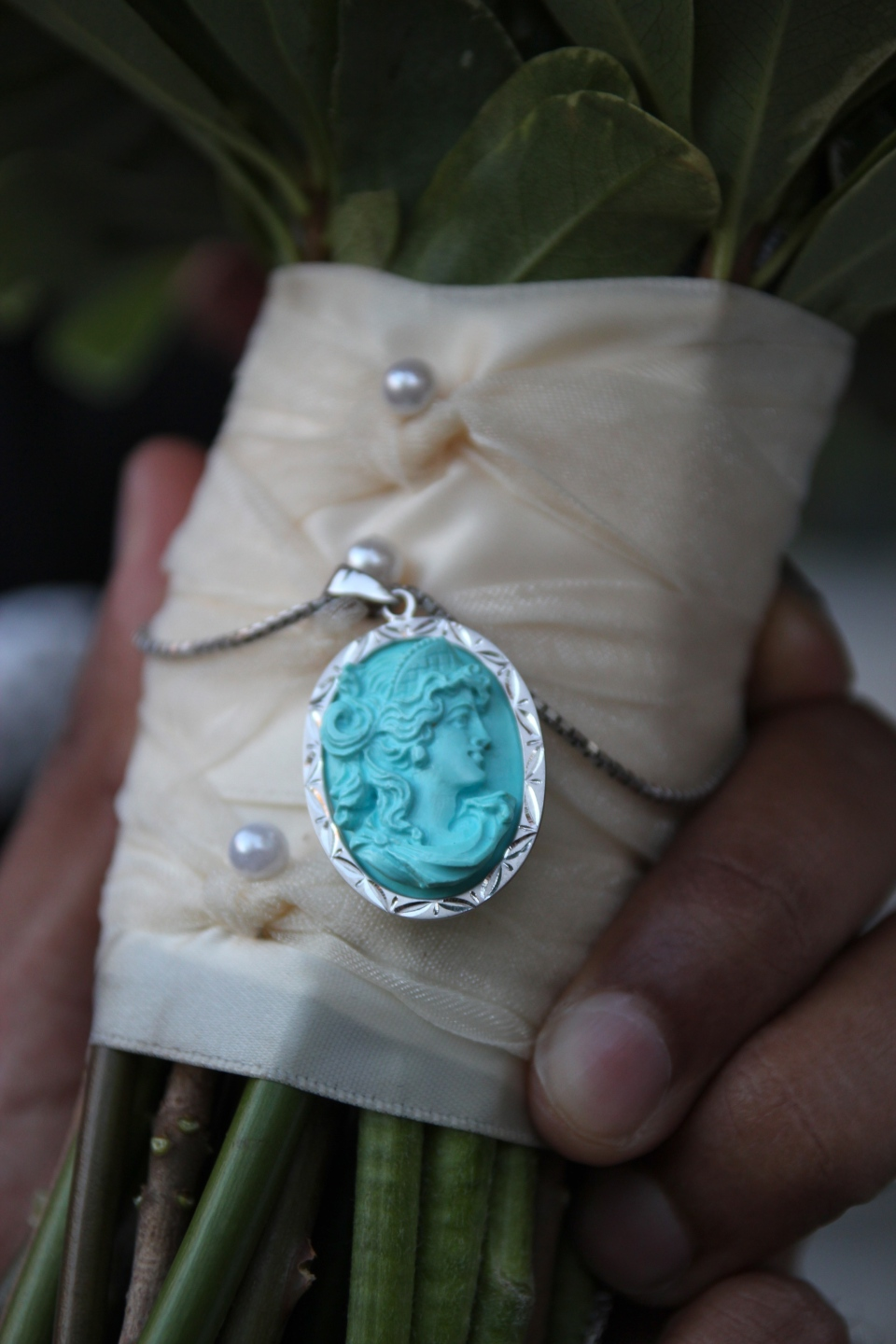 The something blue pendant was pinned to the bouquet handle