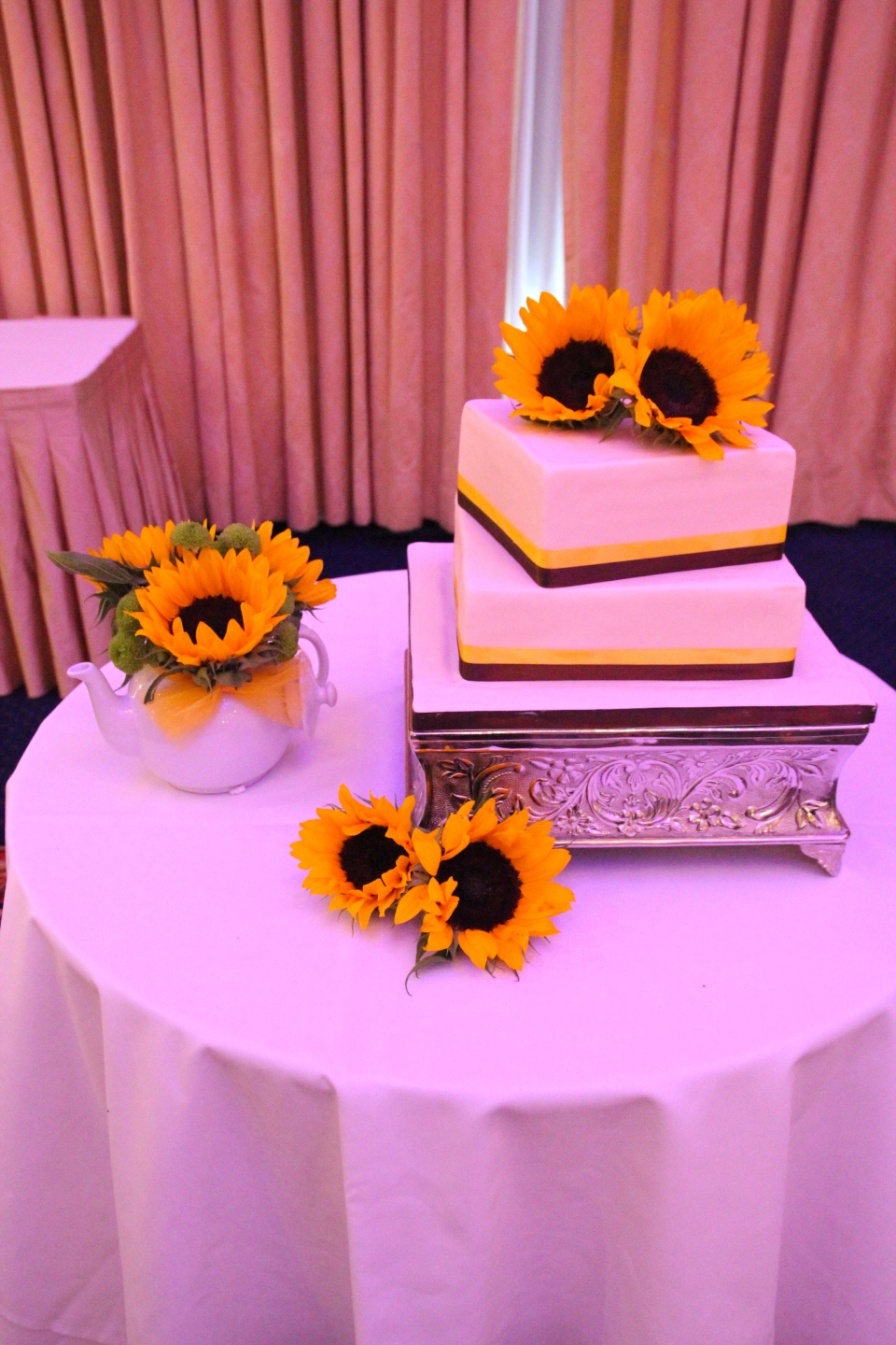 Fresh sunflowers on the cake