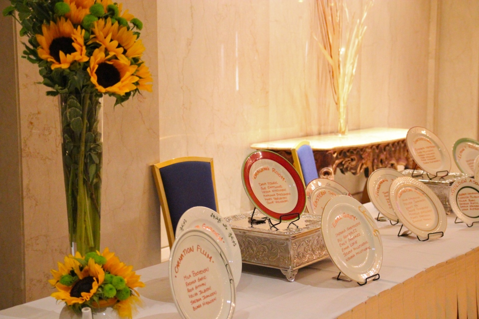 Entry table with large arrangements of sunflowers