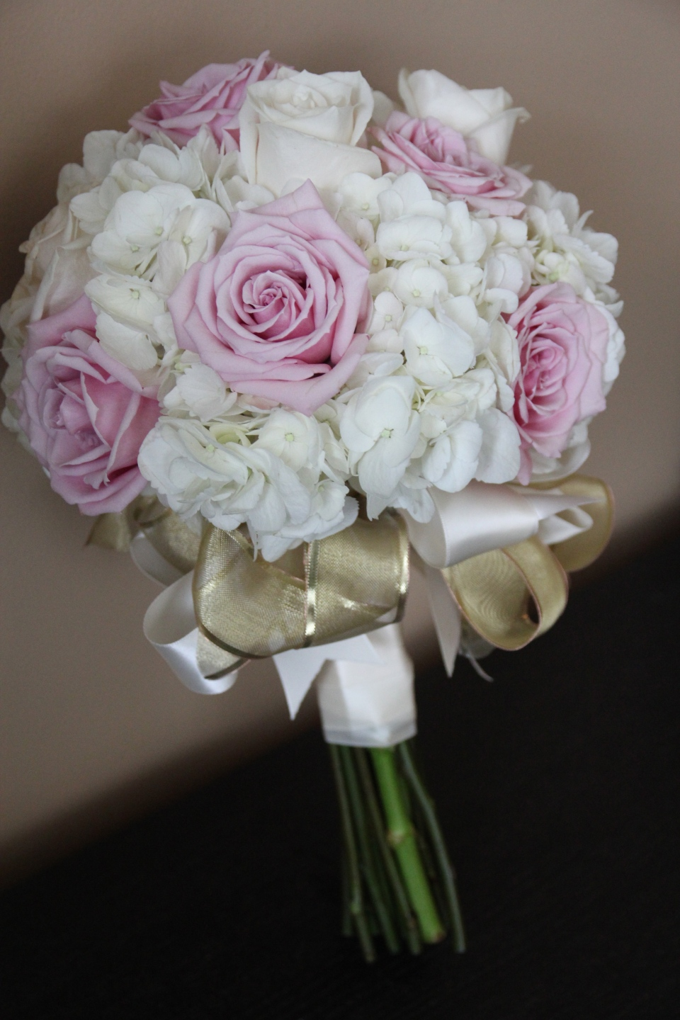 Bridesmaid bouquet of hydrangea and roses with ribbon collar