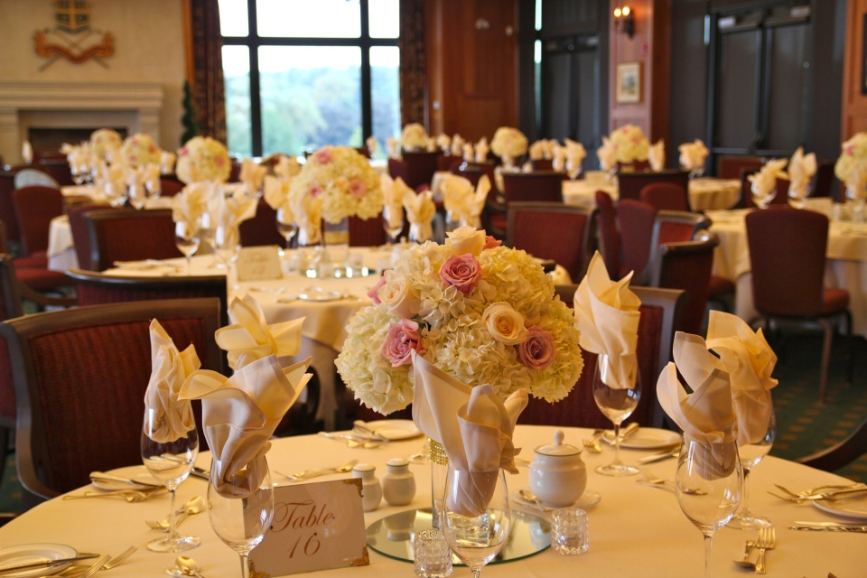 Blush and ivory centerpieces of hydrangea and roses