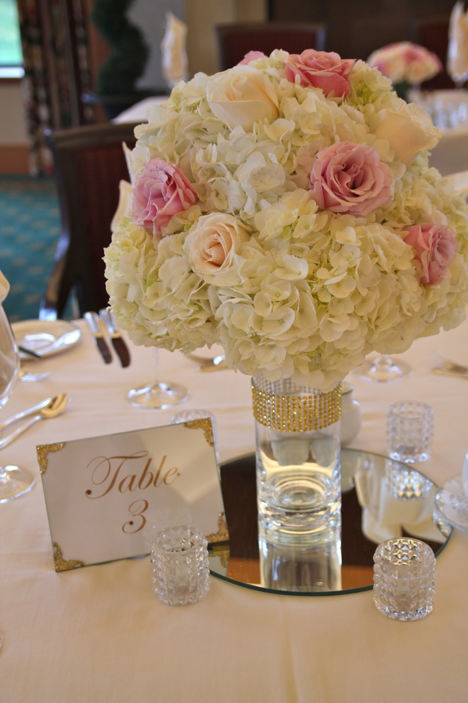 Ivory hydrangea globes with pink and ivory roses