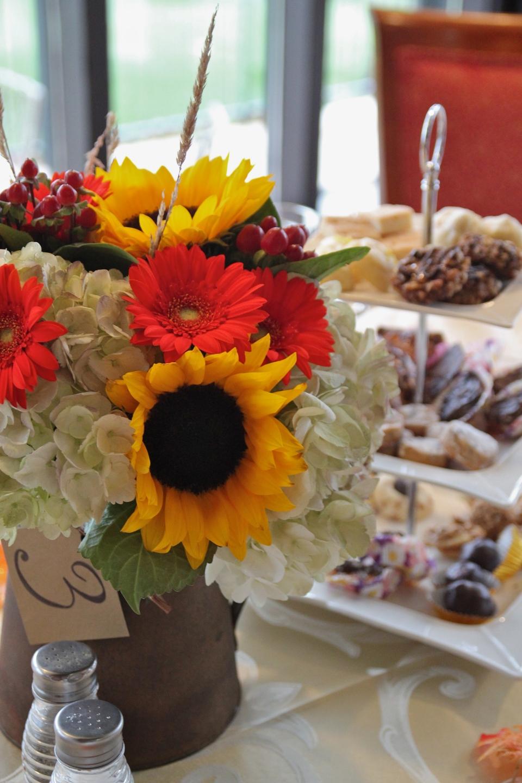 Centerpiece ofhydrangea, sunflowers, gerbera daisies, berries & wheat stalks