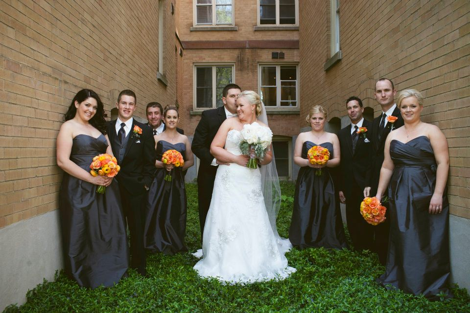 Great shot of the bridal party showcasing the slate grey and orange colour scheme. Photo Credit: www.redbuttonphotography.com