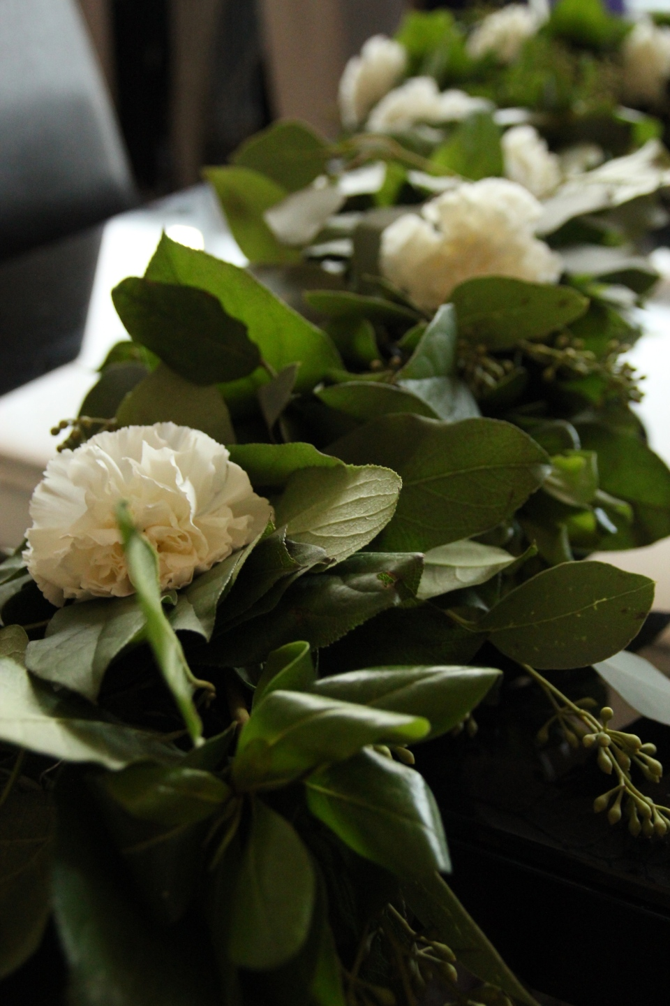 Handmade garland of greenery & white carnations