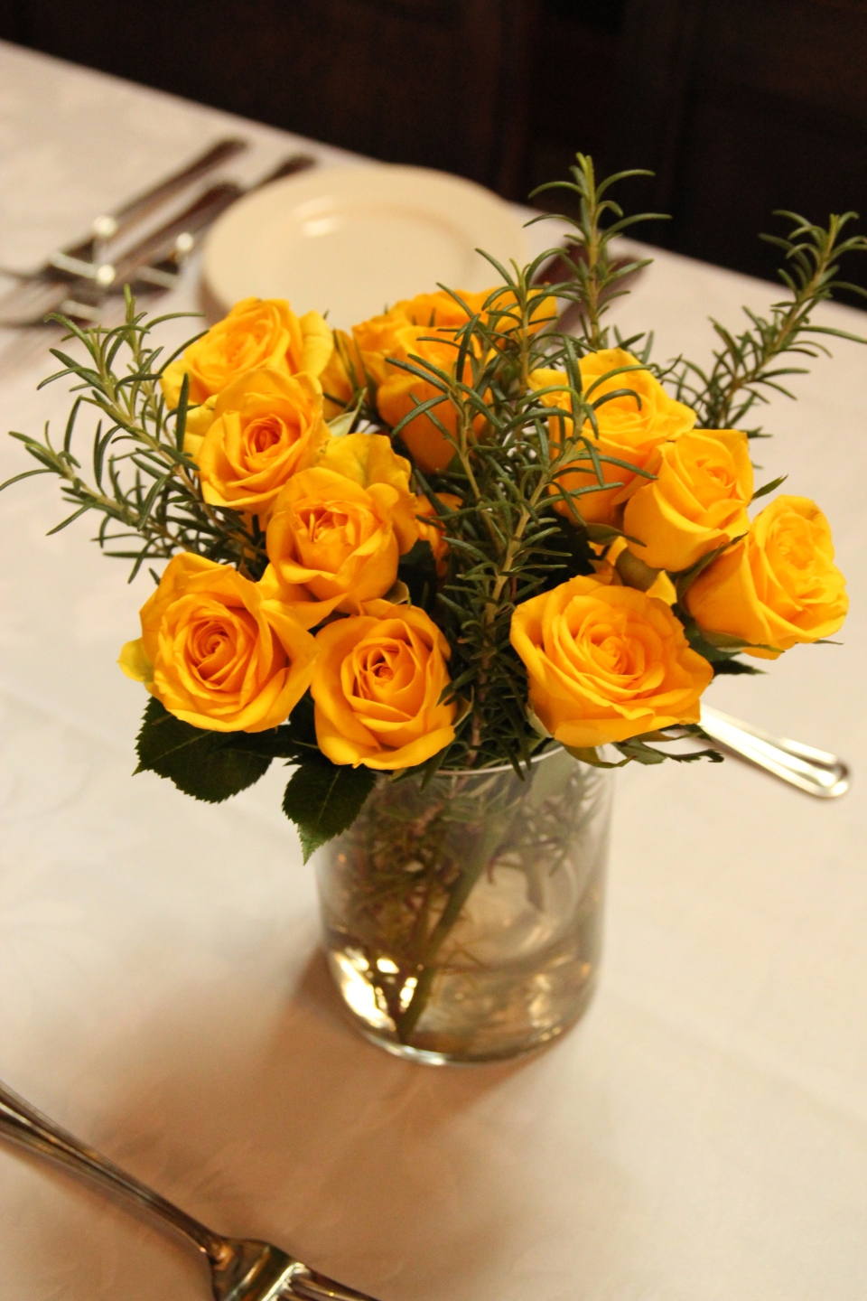 An abundance of yellow spray roses & rosemary sprigs
