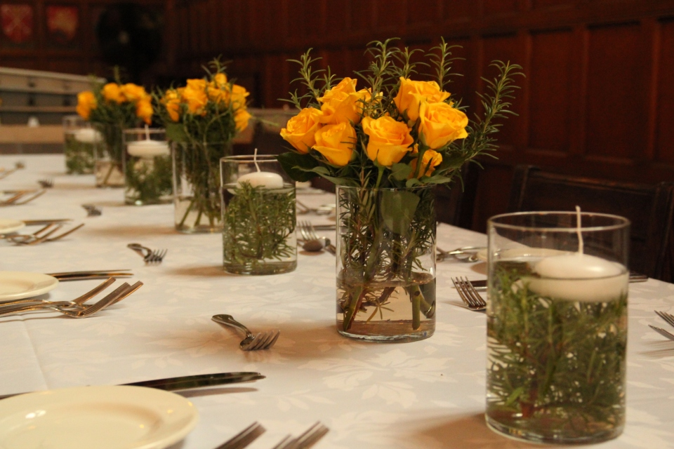 Florals & candles all lined up down the length of each table