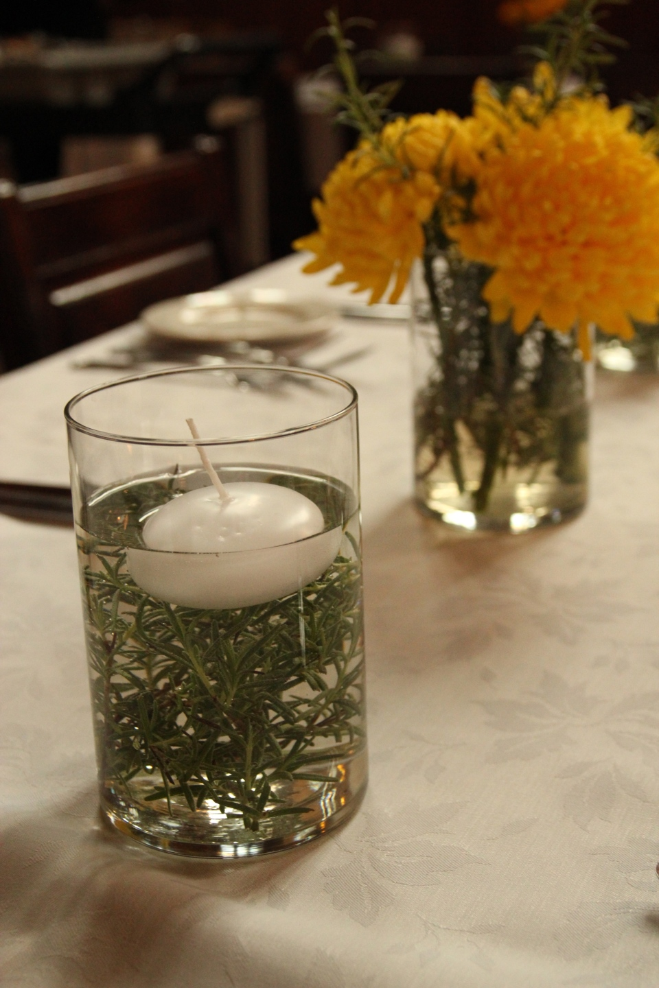Submerged rosemary floating candles